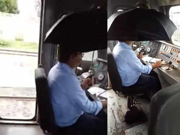 Train Driver Holds Umbrella In Dripping Cabin